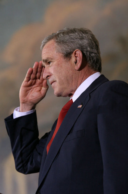 "President George W. Bush salutes members of the Tuskegee Airmen during ceremonies at the U.S. Capitol Thursday, March 29, 2007, honoring America's first African-American military airmen with the Congressional Gold Medal. The President told the men, ""I would like to offer a gesture to help atone for all the unreturned salutes and unforgivable indignities. And so, on behalf of the office I hold, and a country that honors you, I salute you for the service to the United States of America."" White House photo by Eric Draper"