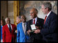 President George W. Bush presents the Congressional Gold Medal to Dr. Roscoe Brown Jr., during ceremonies honoring the Tuskegee Airmen Thursday, March 29, 2007, at the U.S. Capitol. Dr. Brown, Director of the Center for Urban Education Policy and University Professor at the Graduate School and University Center of the City University of New York, commanded the 100th Fighter Squadron of the 332 Fighter Group during World War II. White House photo by Eric Draper
