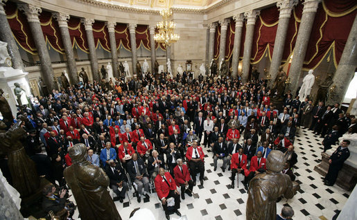 President George W. Bush and Speaker of the House of Representatives Nancy Pelosi stand amidst 300 Tuskegee Airmen during a photo opportunity Thursday, March 29, 2007, in Statuary Hall at the U.S. Capitol. White House photo by Joyce Boghosian