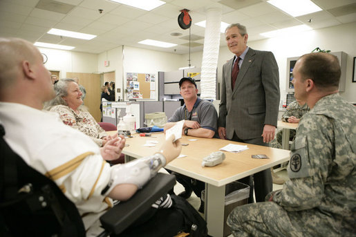 President George W. Bush talks with the Shirley family of Labelle, Fla., Friday, March 30, 2007, during a visit to Walter Reed Army Medical Center in Washington, D.C. Pictured, from left, is U.S. Army Sgt. Luke Shirley, his mother Bonniesue Whitehead, his brother Joshua James Shirley, who is a Specialist in the U.S. Army, and an unidentified hospital staff member. White House photo by Eric Draper