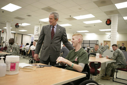 President George W. Bush talks with U.S. Marine Corps 2nd Lt. Andrew Kinard of Spartanburg, S.C., Friday, March 30, 2007, during a visit to Walter Reed Army Medical Center in Washington, D.C. White House photo by Eric Draper