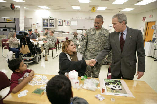 President George W. Bush meets with the family of Sgt. William Enriquez Santos of Carolina, Puerto Rico, Friday, March 30, 2007, during a visit to Walter Reed Army Medical Center in Washington, D.C. Pictured from left are Sgt. Santos' sons, Josh, 8 and John, 17, and his wife Betsy Rodriguez. White House photo by Eric Draper