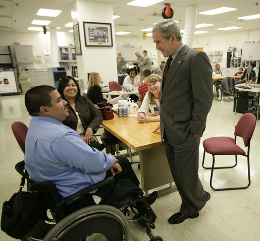 President George W. Bush talks with U.S. Army Staff Sgt. Joe Beimfohr and his fiancee Ana Rivera, both of Winchester, Tenn., located near Chattanooga Friday, March 30, 2007, during a visit to Walter Reed Army Medical Center in Washington, D.C. White House photo by Eric Draper