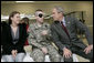 President George W. Bush talks with U.S. Army Sgt. Joel Robert Kalka and his girlfriend and caregiver, Amanda Sue Sink, both of Wailiku, Maui, Hawaii, Friday, March 30, 2007, during a visit to Walter Reed Army Medical Center in Washington, D.C. White House photo by Eric Draper