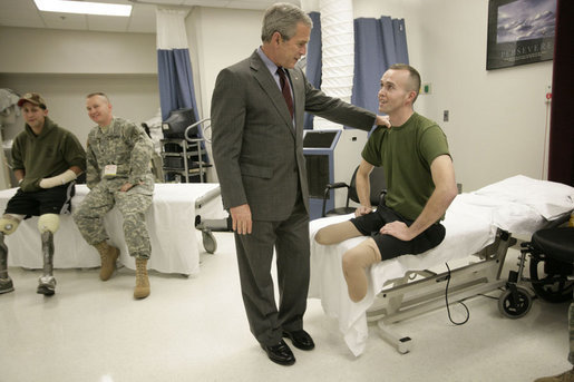 President George W. Bush talks with U.S. Marine Corps Bradley Jerome Walker of White Pine, Tenn., Friday, March 30, 2007, during a visit to Walter Reed Army Medical Center in Washington, D.C. White House photo by Eric Draper