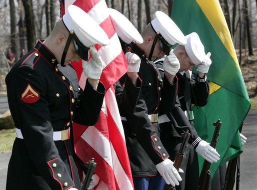 Members of the military honor guard at Camp David bow their heads and hold their hats at the helicopter arrival of Brazilian President Luiz Inacio Lula da Silva, who arrived for a meeting with President George W. Bush, Saturday, March 31, 2007, at the Presidential retreat in Maryland. White House photo by Eric Draper