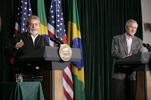 President George W. Bush listens as Brazilian President Luiz Inacio Lula da Silva answers a reporter's question during their joint news conference Saturday, March 31, 2007, at Camp David. White House photo by Eric Draper