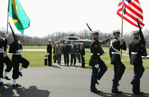 President George W. Bush and Mrs. Laura Bush welcome Brazilian President Luiz Inacio Lula da Silva Saturday, March 31, 2007 to Camp David, as a military honor guard passes in review. White House photo by Joyce Boghosian