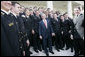 President George W. Bush meets with members of the U. S. Naval Academy football team, after presenting the team with the Commander-In-Chief trophy at the White House, Monday, April 2, 2007. White House photo by Eric Draper