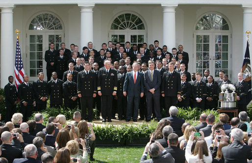 President George W. Bush welcomes members the U. S. Naval Academy football team to the White House, where he presented the Commander-In-Chief trophy to the team in ceremonies in the Rose Garden at the White House, Monday, April 2, 2007. White House photo by Joyce Boghosian