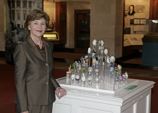 Mrs. Laura Bush stands next to 51 State Eggs decorated by artists from each state and the District of Columbia Tuesday, April 3, 2007, at the White House Visitor Center in Washington, D.C. The tradition of the State Egg Display for Easter began in 1994. Each year the artists vote amongst themselves to select the artist to create the following year's commemorative egg which is presented to the President and First Lady. White House photo by Shealah Craighead