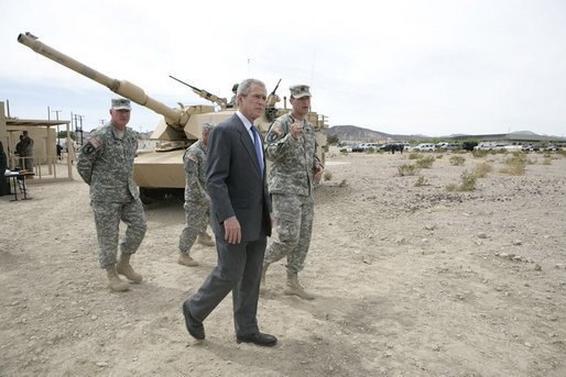 President George W. Bush talks with U.S. Army Captain Pat Armstrong during his visit to the U.S. Army National Training Center Wednesday, April 4, 2007, at Fort Irwin, Calif. White House photo by Eric Draper