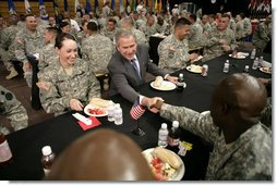 President George W. Bush greets military personnel during lunch at Fort Irwin, Calif., where President Bush addressed the troops and their family members at the U.S.Army's National Training Center. White House photo by Eric Draper