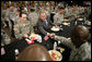 President George W. Bush greets military personnel during lunch at Fort Irwin, Calif., where President Bush addressed the troops and their family members at the U.S. Army's National Training Center. White House photo by Eric Draper