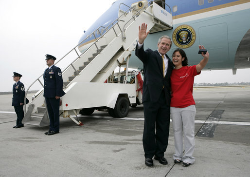 President George W. Bush and USA Freedom Corps greeter Hannah Locke wave to the press cameras, Wednesday, April 4, 2007 at Los Angeles International Airport. Locke, who was presented with the President's Volunteer Service Award, is a volunteer with Jumpstart, a national program that pairs college students with at-risk preschool children to help them develop literacy, language and social skills. White House photo by Eric Draper