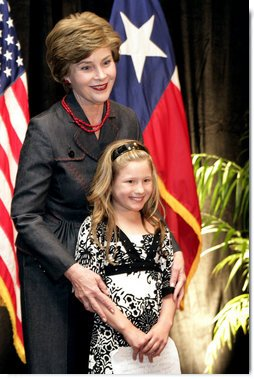 Mrs. Laura Bush hugs Rae Leigh Bradbury Wednesday, April 4, 2007, in Austin, after the 9-year-old introduced Mrs. Bush during the announcement of the future opening of the Texas Regional Office of the National Center for Missing and Exploited Children. Rae Leigh was the first child in the United States to be recovered as a result of an AMBER Alert when she was 8 weeks old in November 1998. So far AMBER Alerts have saved more than 300 young lives in the United States.  White House photo by Shealah Craighead