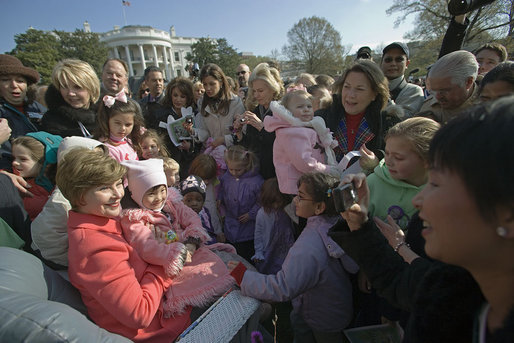 "Mrs. Laura Bush poses for pictures with children after reading aloud the children's book, ""Duck For President,"" by Doreen Cronin and Betsy Lewin Monday, April 9, 2007, at the 2007 White House Easter Egg Roll on the South Lawn. White House photo by Shealah Craighead"