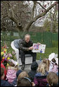"Interior Secretary Dirk Kempthorne reads the children's book, ""Officer Buckle and Gloria,"" by Peggy Rathmann during the 2007 White House Easter Egg Roll on the South Lawn. White House photo by Shealah Craighead"