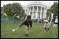 Eggs roll, drop, hop and even fly as children take part in the traditional mainstay of the 2007 White House Easter Egg Roll on the South Lawn Monday, April 9 2007. White House photo by Shealah Craighead