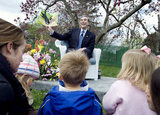 "Commerce Secretary Carlos Gutierrez reads from the children's book, ""Duck on a Bike,"" by David Shannon Monday, April 9, 2007, during the 2007 White House Easter Egg Roll on the South Lawn. White House photo by David Bohrer"