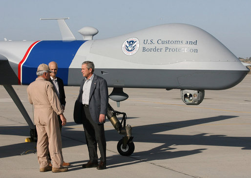 "Standing next to a Predator Drone, Maj. Gen. Mike Kostelnik speaks with President George W. Bush and Secretary Michael Chertoff of Homeland Security during their tour Monday, April 9, 2007, of the U.S.-Mexico border in Yuma, Ariz. Said the President, ""It's the most sophisticated technology we have, and it's down here on the border to help Border Patrol agents do their job."" White House photo by Eric Draper"