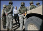 President George W. Bush stands amidst camouflaged troops Monday, April 9, 2007, during his tour of the U.S.-Mexico border in Yuma, Ariz. White House photo by Eric Draper
