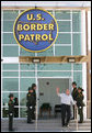 "President George W. Bush waves from the new Yuma Border Patrol Station building Monday, April 9, 2007, during his visit to the Arizona border community to speak on immigration reform. The President told his audience, ""We need to work together to come up with a practical solution to this problem, and I know people in Congress are working hard on this issue."" White House photo by Eric Draper"