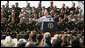 "President George W. Bush speaks on immigration reform during a stop Monday, April 9, 2007, in Yuma, Ariz. Said the President, ""I can't think of a better place to come and to talk about the good work that's being done and the important work that needs to be done in Washington, D.C., and that's right here in Yuma, Arizona, a place full of decent, hardworking, honorable people."" White House photo by Eric Draper"