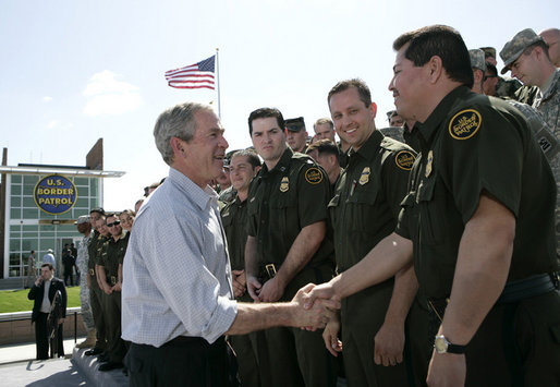 "President George W. Bush shakes hands with agents after speaking Monday, April 9, 2007, at the new Yuma Border Patrol Station on comprehensive immigration reform. Speaking in the Arizona border city, the President told his audience, ""We've got to resolve the status of millions of illegal immigrants already here in the country. So we're working closely with Republicans and Democrats to find a practical answer that lies between granting automatic citizenship to every illegal immigrant and deporting every illegal immigrant."" White House photo by Eric Draper"