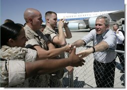 President George W. Bush reaches out to Marines as he prepares to depart the Yuma Marine Corps Air Station in Yuma, Ariz. The stop in the border city was the last before returning to Washington, D. C. after a Easter weekend in Texas.  White House photo by Eric Draper