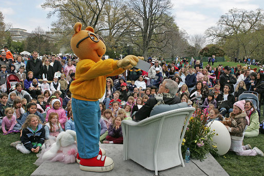 "White House Chief of Staff Josh Bolten gets a little help from Arthur in telling his tale of, ""Arthur Meets the President,"" by Marc Brown Monday, April 9, 2007, on the South Lawn during the 2007 White House Easter Egg Roll. White House photo by Joyce Boghosian"
