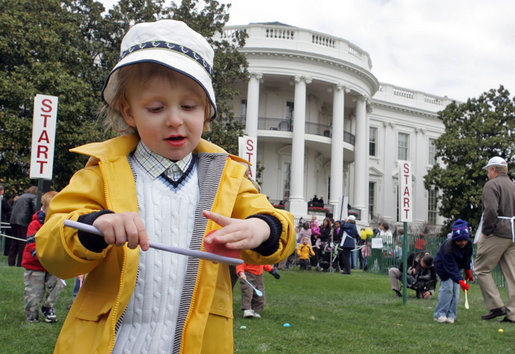 A little boy is careful not to drop his egg as he carries it through the Easter Egg Roll Monday, April 9, 2007, on the South Lawn during the 2007 White House Easter Egg Roll. White House photo by Joyce Boghosian
