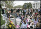 "Actor Stephen Baldwin asks a little reader for some help as he reads the children's book, ""The Jolly Postman,"" by Alan Alhberg Monday, April 9, 2007, on the South Lawn during the 2007 White House Easter Egg Roll. White House photo by Joyce Boghosian"