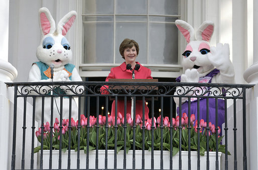"Mrs. Laura Bush addresses South Lawn visitors to the 2007 White House Easter Egg Roll from the Truman Balcony Monday, April 9, 2007. ""In Washington, we know spring has arrived when the White House lawn is filled with children for the Easter Egg Roll,"" said Mrs. Bush. ""So thank each one of the children for coming. Thank you for bringing an adult with you."" White House photo by Shealah Craighead"