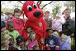 Mrs. Bush poses with children and Clifford the Big Red Dog on the South Lawn during the 2007 White House Easter Egg Roll Monday, April 9, 2007. There were many children's characters in attendance including Charlie Brown, Bugs Bunny, Arthur, and Curious George. White House photo by Shealah Craighead