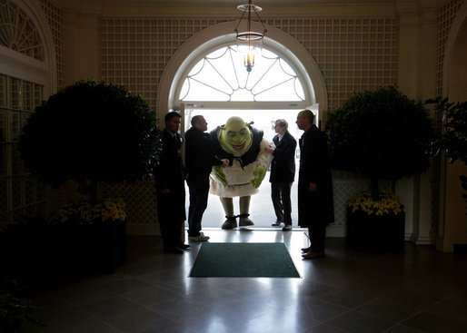 Shrek receives some assistance as he ducks entering the Palm Room of the White House Monday, April 9, 2007. The big guy was on hand to participate in the 2007 White House Easter Egg Roll. White House photo by David Bohrer