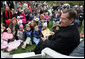 "Health and Human Services Secretary Mike Leavitt prepares to read from the book, ""Faux Paw's Adventures in the Internet: Keeping Children Safe,"" authored by his wife, Mrs. Jacalyn Leavitt, Monday, April 9, 2007, during the 2007 White House Easter Egg Roll. White House photo by David Bohrer"