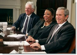 President George W. Bush talks with the press Thursday, April 12, 2007, after meeting about the No Child Left Behind Act with leaders in education, business the civil rights movement in the Roosevelt Room. Pictured with the President are Bill Taylor, Chairman of the Citizens' Commission on Civil Rights, and Shelia Evans-Tranumn, Associate Commissioner of Education for New York State. White House photo by Joyce N. Boghosian