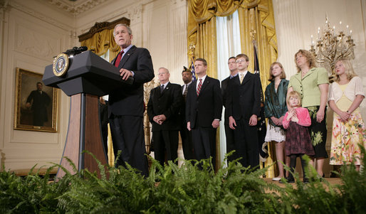 President George W. Bush, joined by military family members, addresses his remarks on the Iraq War supplemental spending bill in the East Room at the White House, Monday, April 16, 2007. President Bush urged Congress to pass an emergency war spending bill, without strings and without further delay. White House photo by Eric Draper