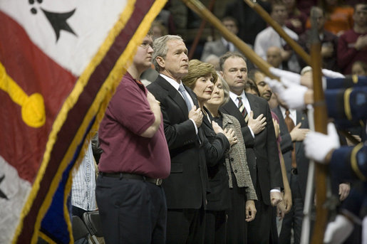 President George W. Bush and Mrs. Laura Bush stand with a hand over their hearts during the Convocation Tuesday, April 17, 2007, in Blacksburg, Va., in honor of the Virginia Tech shooting victims. Virginia Governor Tim Kaine and his wife, Anne Holton are seen at right. White House photo by Eric Draper