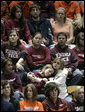 Students comfort each other during a Convocation on the Virginia Tech campus Tuesday, April 17, 2007, honoring the victims of a deadly shooting Monday. Thirty-three people, including the gunman, died in the rampage at the Blacksburg, Va. school. White House photo by Eric Draper