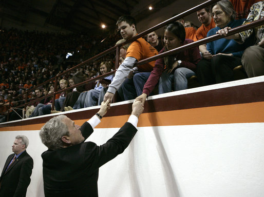 President George W. Bush reaches up to students at Virginia Tech while attending a Convocation Tuesday, April 17, 2007, honoring those involved with Monday's shootings. Thirty-three people, including the gunman, were killed during the country's deadliest shooting that occurred on the campus of the Blacksburg, Va. campus. White House photo by Eric Draper