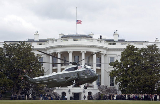 As the American flag flies at half staff in memory of the 33 who died Monday at Virginia Tech, Marine One, with President George W. Bush and Mrs. Laura Bush aboard, lifts off the South Lawn Tuesday, April 17, 2007, en route to Andrews Air Force Base. The President and Mrs. Bush were headed to Blacksburg, Va., home of Virginia Tech, and the Convocation scheduled in the wake of Monday's tragedy. White House photo by Joyce Boghosian
