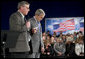 President George W. Bush bows his head Thursday, April 19, 2007, as Steve Bruns, President Emeritus of the Tipp City (Ohio) Chamber of Commerce, extends a moment of silence in memory of those killed in Monday's shootings at Virginia Tech. The President visited Ohio to deliver remarks on the global war on terror. White House photo by Eric Draper