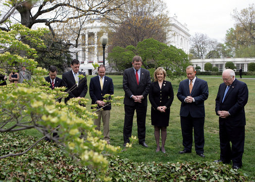 Vice President Dick Cheney stands with Oklahoma City Mayor Mick Cornett, second right, and the Oklahoma Congressional delegation Thursday, April 19, 2007, during a moment of silence on the South Lawn of the White House to commemorate the April 19, 1995 bombing of the Alfred P. Murrah Federal Building in Oklahoma City. The moment of silence was observed in front of a White Dogwood tree planted by former President Bill Clinton and Mrs. Hillary Clinton in honor of the 168 people who lost their lives in the tragedy. White House photo by Eric Draper