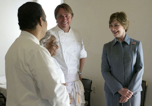 Mrs. Laura Bush talks with 93-year-old restaurant owner Willie Mae Seaton, center, her grandson Ronnie Seaton, Sr., left, and Chef John Besh of Restaurant August at Willie Mae's Scotch House Thursday, April 19, 2007, in New Orleans, La. The restaurant was destroyed in Hurricane Katrina. White House photo by Shealah Craighead