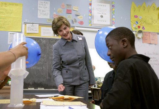 Mrs. Laura Bush watches a student demonstrate an experiment with static electricity and a balloon at the New Orleans Charter Science and Mathematics High School Thursday, April 19, 2007, in New Orleans, La. Originally created as a half-day program in 1992, the program reorganized itself as The New Orleans Charter Science and Mathematics High School after Hurricane Katrina sent the city's school system into a state of crisis. White House photo by Shealah Craighead