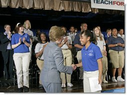 "Mrs. Laura Bush thanks 11th grade student Ashley Joplin, who introduced the First Lady, at the New Orleans Charter Science and Mathematics High School Thursday, April 19, 2007, in New Orleans, La. ""According to the United States Department of Education, more than 1,000 private and public schools in the Gulf Coast region were damaged or destroyed,"" said Mrs. Bush. ""Today, 94 percent of the schools in Louisiana have reopened. In New Orleans, 58 public schools are now up and running."" White House photo by Shealah Craighead"