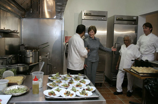 Mrs. Laura Bush tours the new kitchen at Willie Mae's Scotch House Thursday, April 19, 2007, in New Orleans, La. The restaurant was destroyed in Hurricane Katrina. Pictured with Mrs. Bush are, from left, Willie Mae's grandson Ronnie Seaton, Sr., 93-year-old Willie Mae Seaton, and Chef John Besh of Restaurant August. White House photo by Shealah Craighead