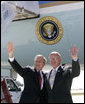 President George W. Bush and Chuck Hinken, of Grand Rapids, Mich., wave after Mr. Hinken was presented the Presidential Volunteer Service Award during the President's visit to Grand Rapids, Mich. Friday, April 20, 2007. The President's Volunteer Service Award recognizes individuals, families, and groups that have achieved a certain standard measured by the number of volunteer hours served over a 12-month period or cumulative hours earned over the course of a lifetime. White House photo by Eric Draper